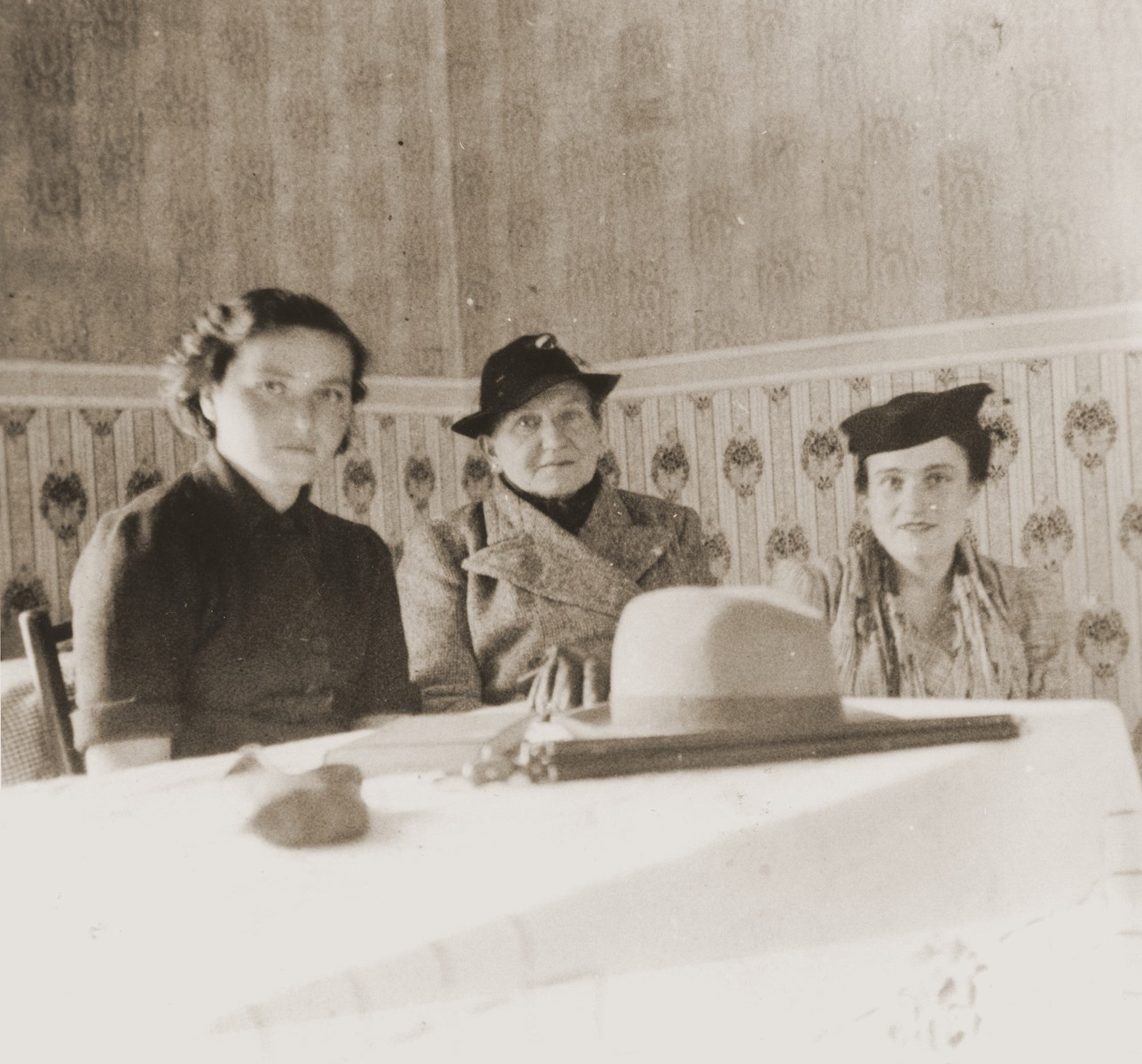 Three Austrian Jewish refugee women seated at a table in La Paz, Bolivia.  Pictured from left to right are Gisi Helfer; Caroline (Lina) Spitzer; and Rose Spitzer.