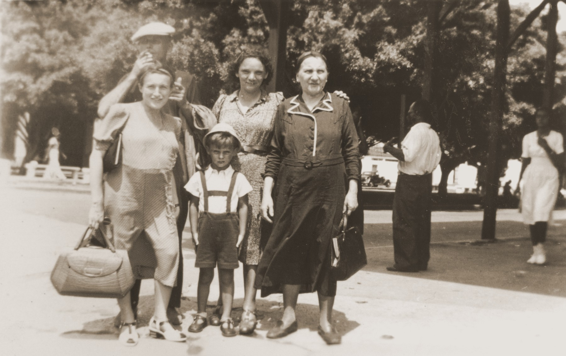 Jewish refugees sailing aboard the SS Virgilio enjoy a  one-day  stopover in Cristobal, Panama on their journey from Italy to Chile.  From Chile they traveled overland to their new homes in La Paz, Bolivia.    Among those pictured are Lina Spitzer (right) and Rosie Spitzer (left).
