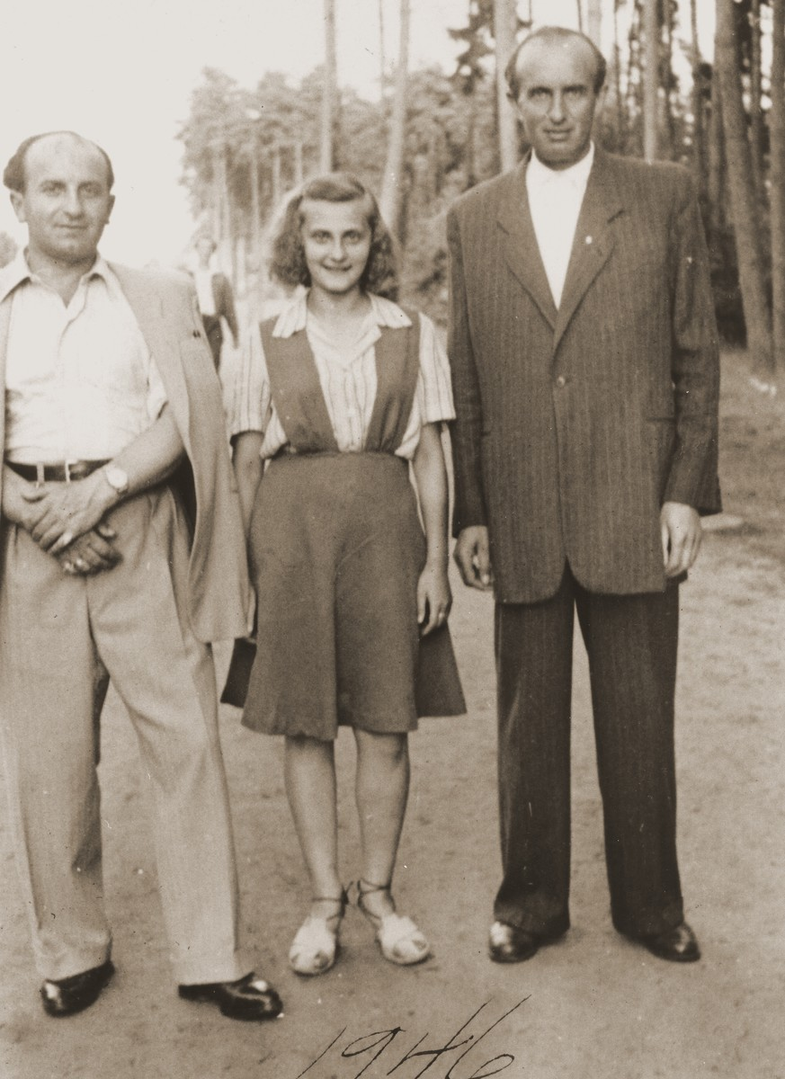 Three Jewish DPs pose outside in the Bergen-Belsen displaced persons camp.  Pictured are Salusia Goldblum (center) and her uncle, Moishe Broda (right).