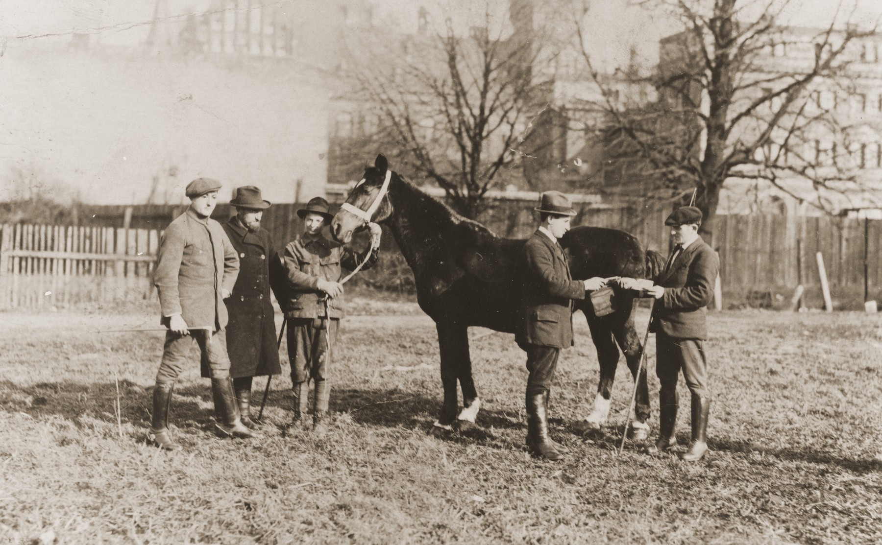 Berl Broda (second from the left) with his sons Aaron and Zalman sell horses at a horse-trading fair in Breslau.
