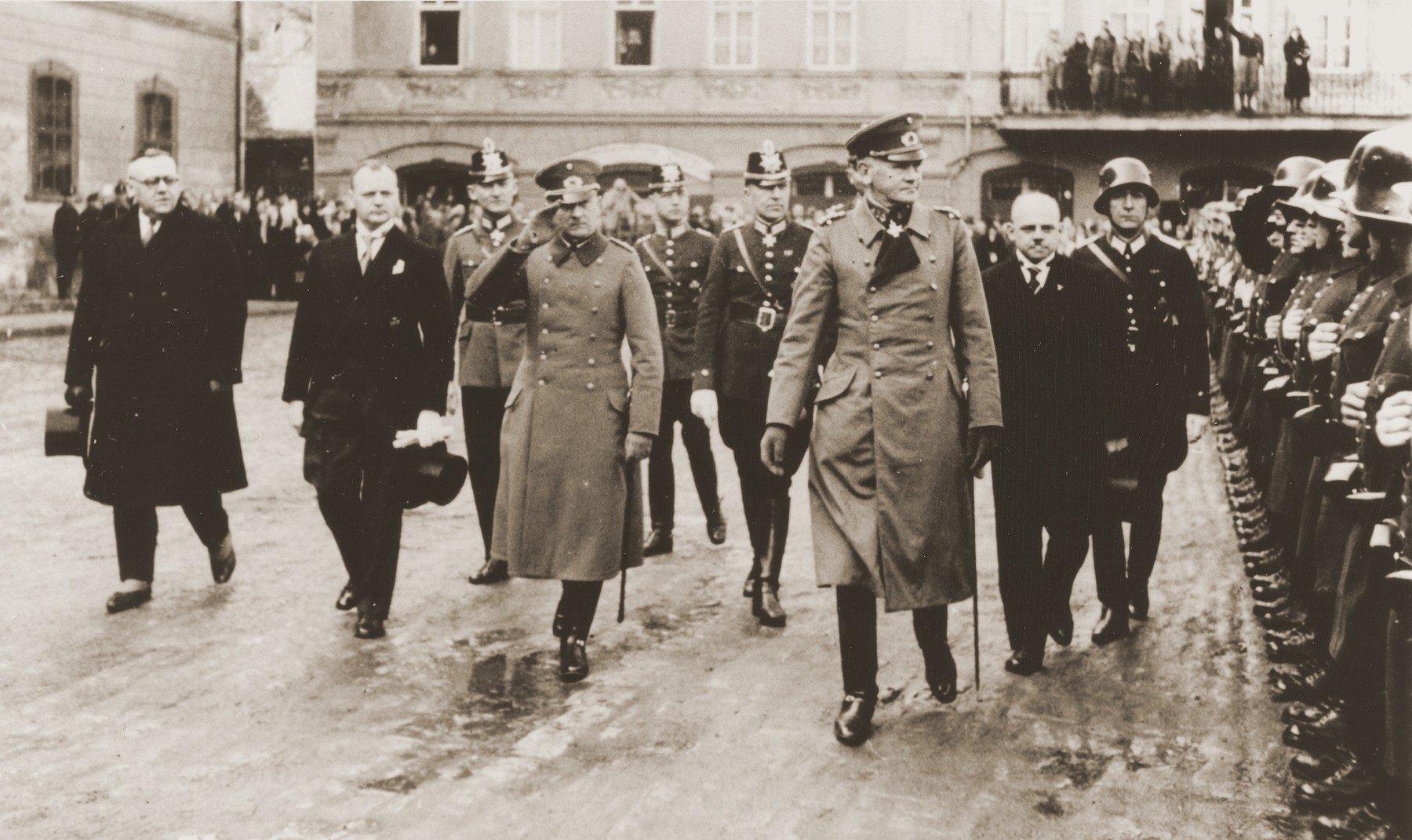 Reichswehrminister General Werner von Blomberg reviews troops during a parade in Weimar in celebration of the electoral victory of March 5, 1933.  Pictured behind von Blomberg on the left is Gauleiter Fritz Saukel.