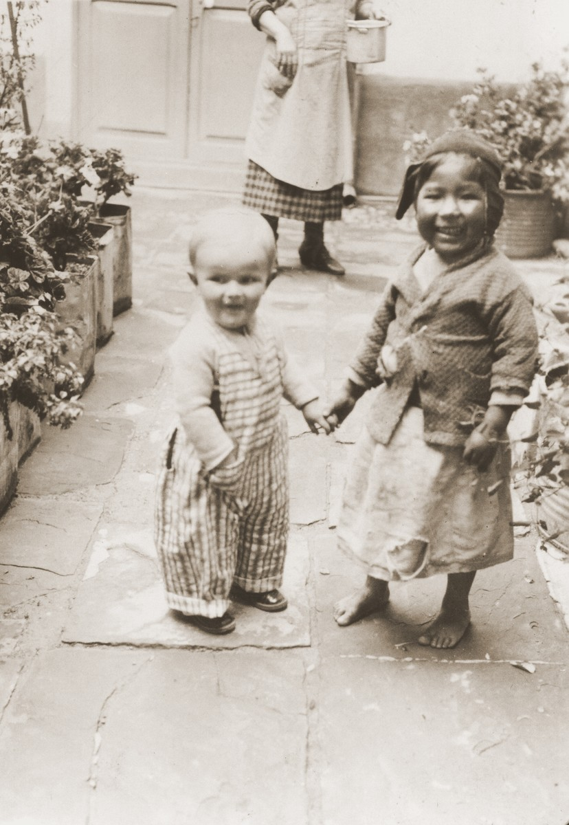 Leo Spitzer and a Bolivian child in the garden of his home in La Paz.