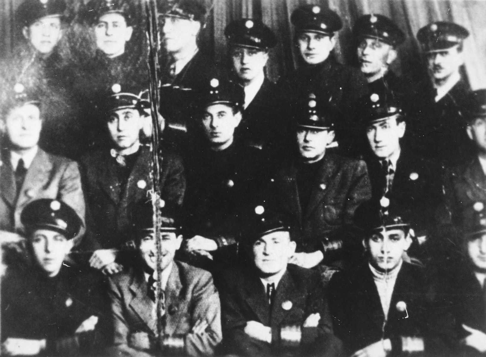 Group portrait of members of the Warsaw ghetto Jewish police.