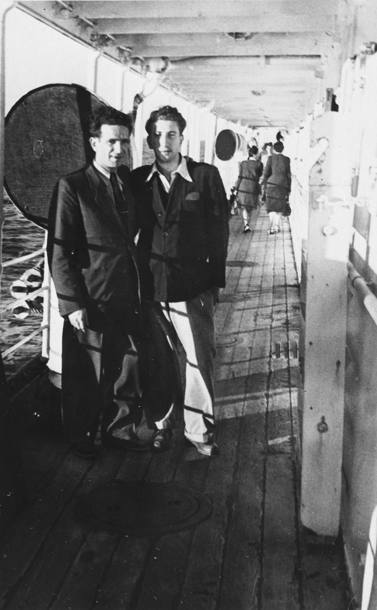 Zygmunt Godzinski (left) poses with a friend on board the SS Desirade en route to Argentina.