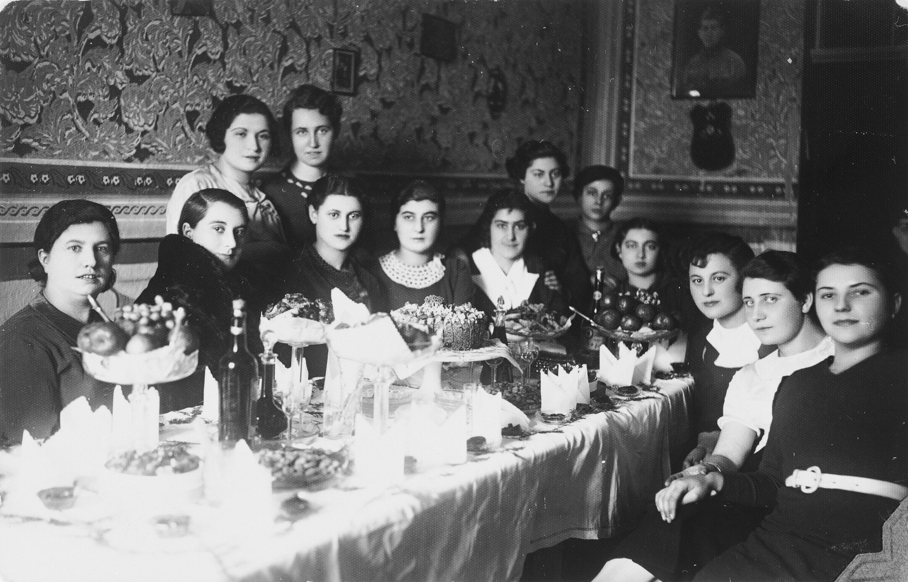Kleinhandler family party in Chmielnik, Poland.  Among those pictured are Haika Silberberg (standing first on the left).