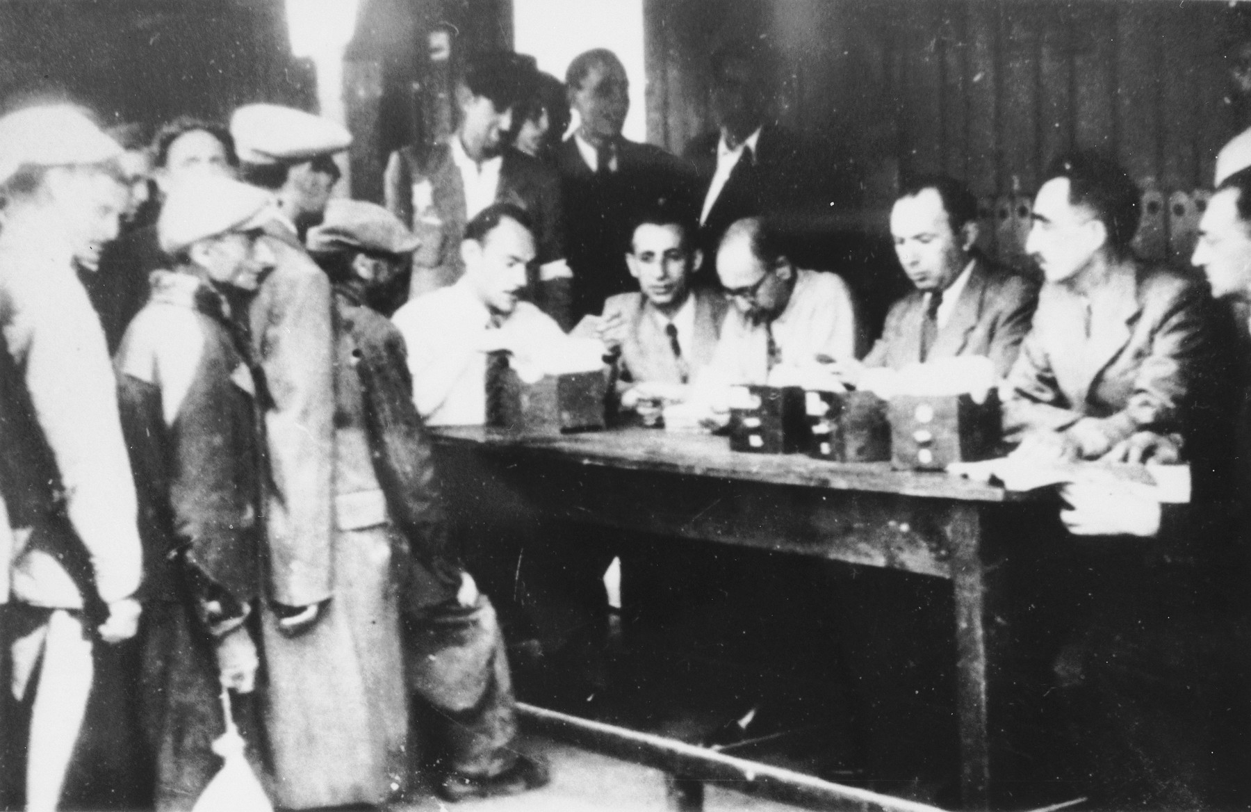 Jews wait in line to register in an unidentified ghetto.