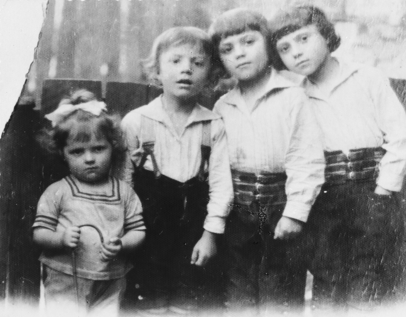 Portrait of four of the Kleinhandler children in Chmielnik, Poland.  Pictured from left to right are: Bluma, Moshe, Leibisz and Avram Kleinhandler.