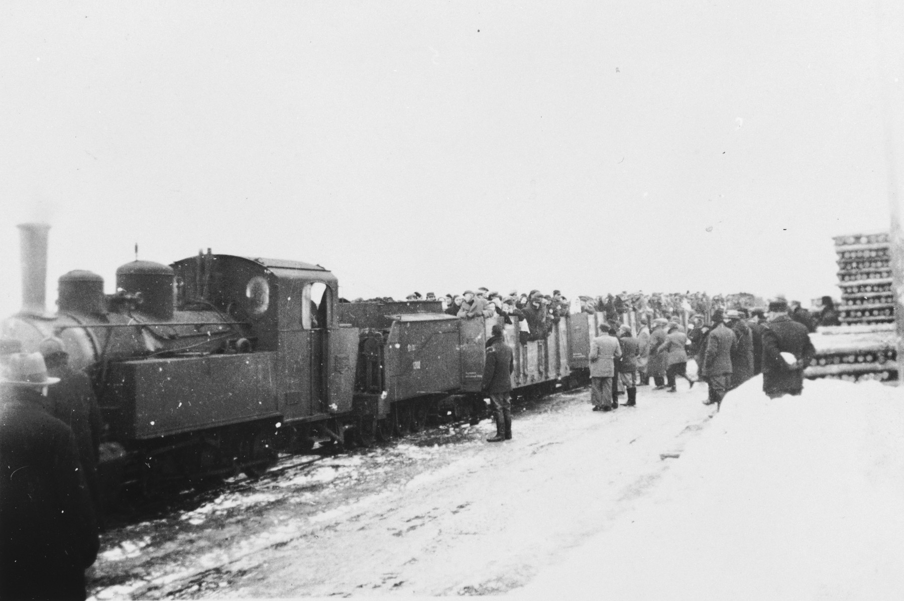 Jews who have been expelled from the town of Plock are resettled in Chmielnik in open train cars.