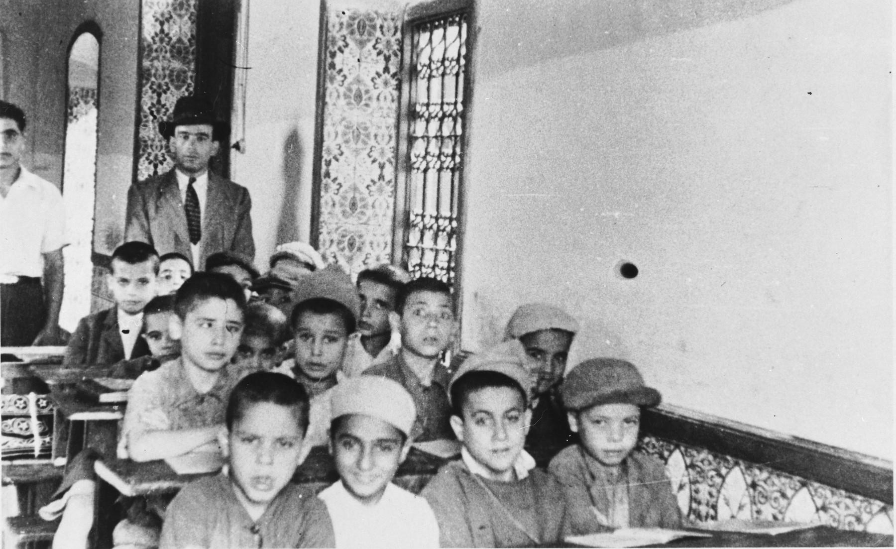 Jewish children study in a Hebrew school in Casablanca.  This photo was taken during the journey of Bluma (Kleinhandler) and Zygmunt Godzinski from Poland to Argentina.