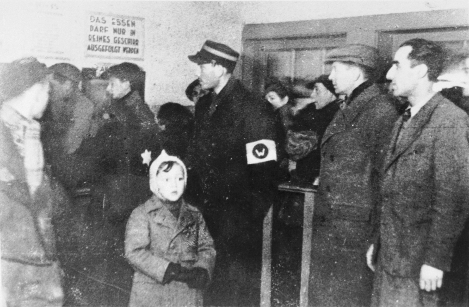 Jews stand in line to get food in the Lodz ghetto.
