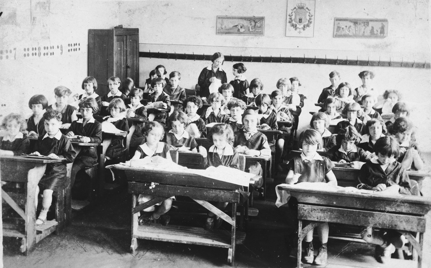 Pupils sit at their desks in a classroom at a public school on Zamarstynowska Street in Lvov.  The school, which was located in a Jewish neighborhood, was populated almost entirely by Jews.  Among those pictured is Tamara Abramowicz (lower left).