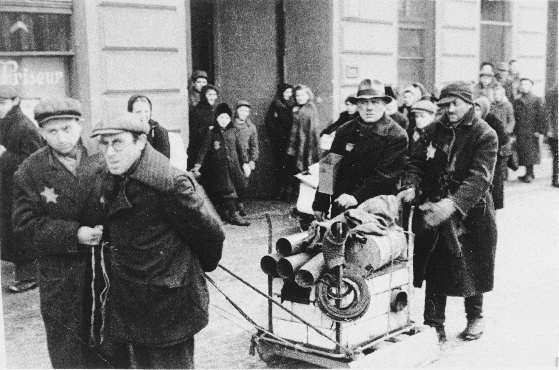 A group of Jewish men haul material through what probably is the Lodz ghetto.