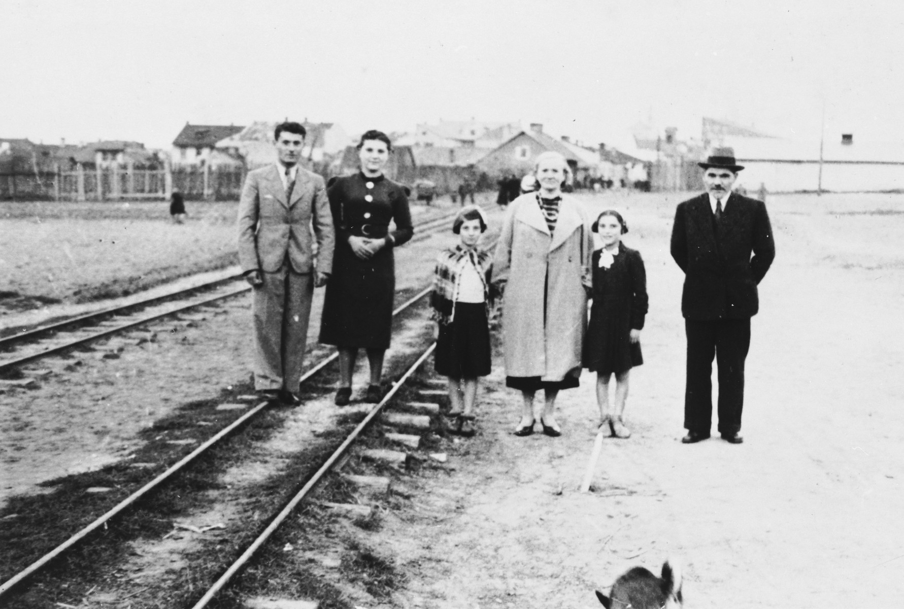 Members of the extended Kleinhandler family pose on a train track at the railroad station in Chmielnik, Poland.  Pictured from left to right are: Avram and Bluma Kleinhandler, Pesele Moszenberg, Chaya Kleinhandler, Zosa Moszenberg and Chaim Kleinhandler.