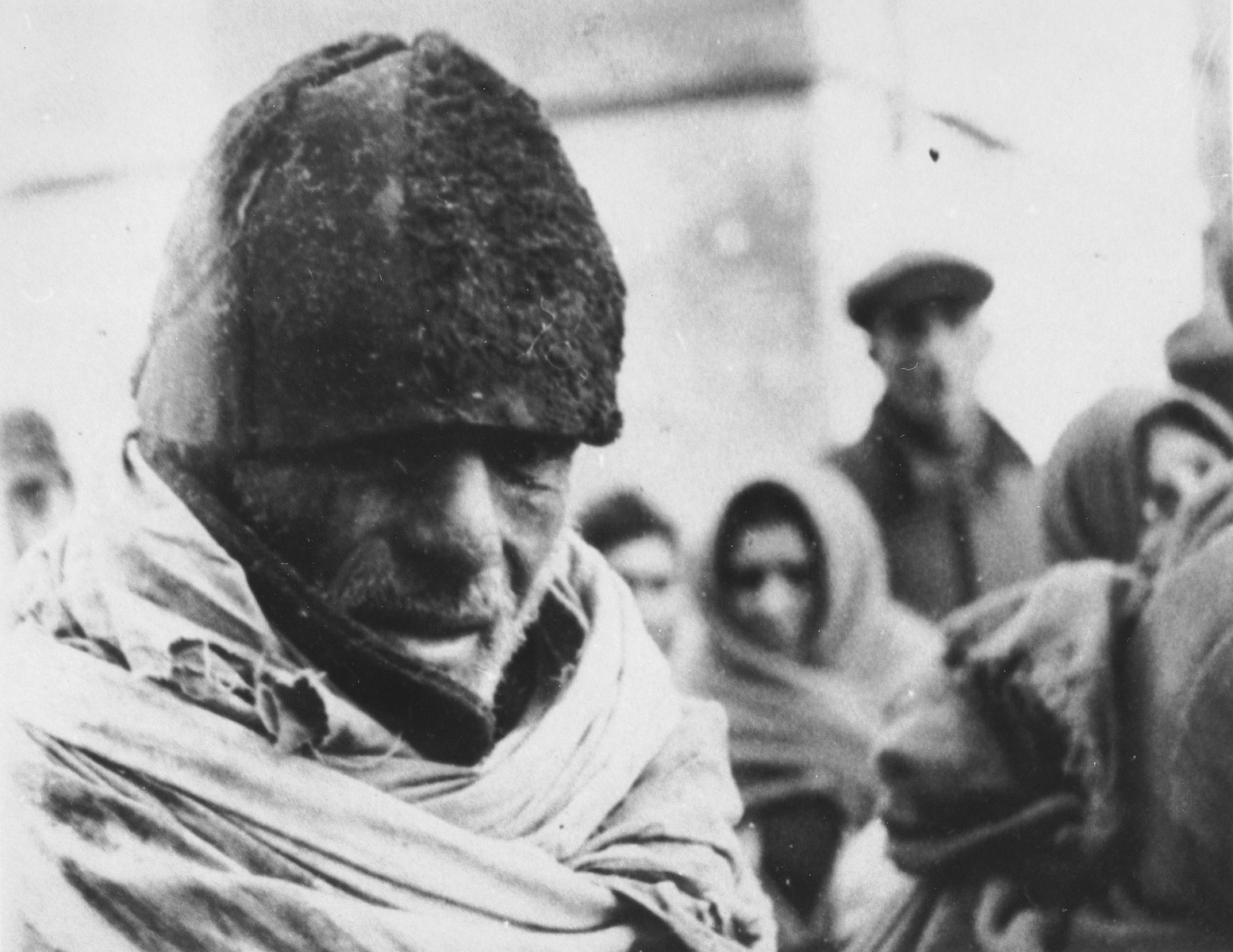 Close-up of a Jewish man wearing a fur cap on a street in an unidentified ghetto.