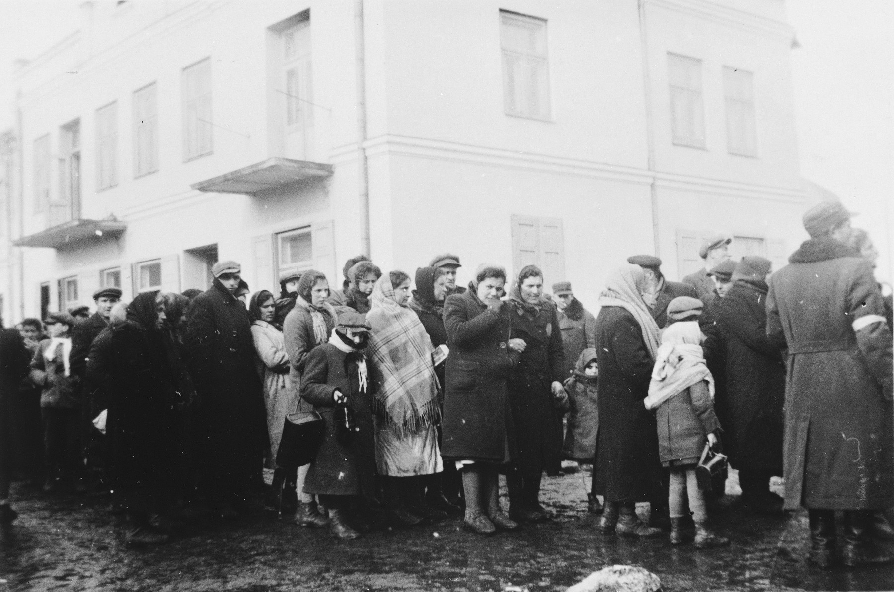 Jews who have been expelled from the town of Plock, wait on a street to be resettled in Chmielnik.