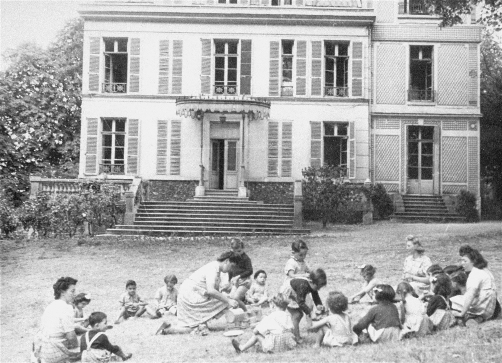 Children at play in the yard of Le Petite Monde children's home.