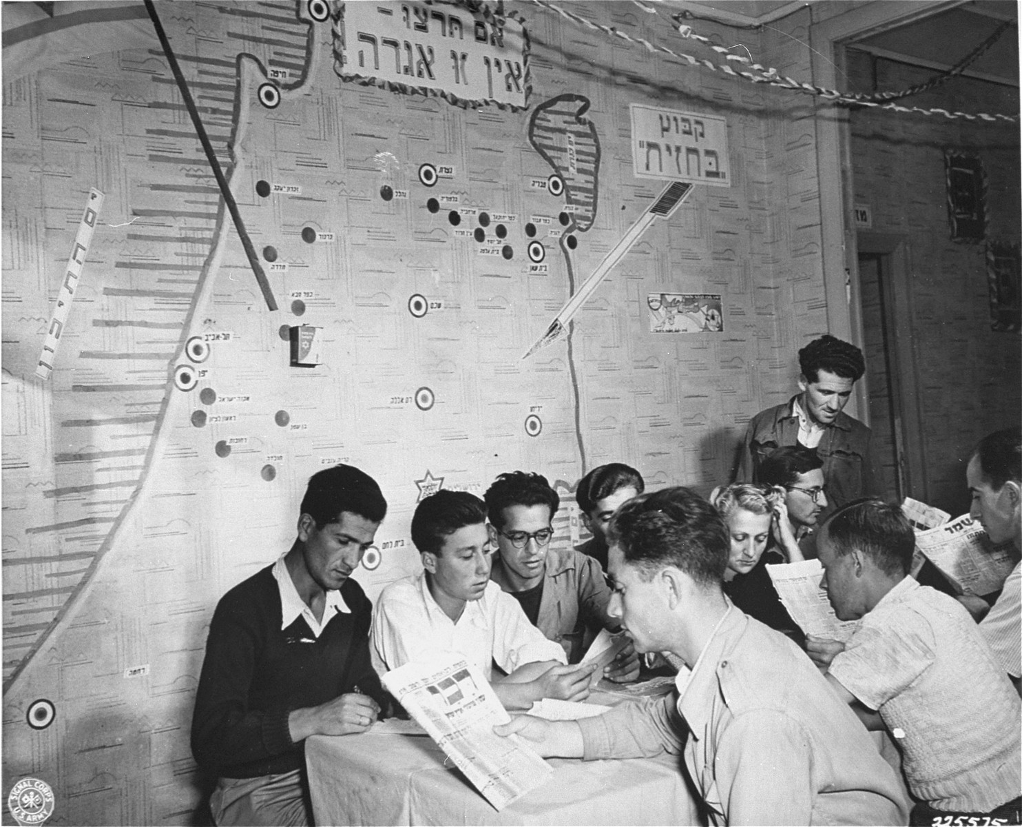 Jewish DPs study in the reading room of a vocational training school supported by the American Joint Distribution Committee.