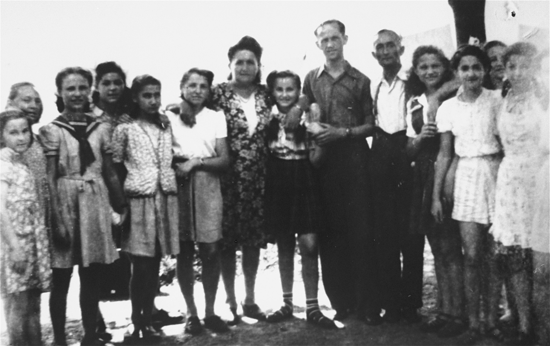 Group portrait of children in the Schirmeck orphanage in France.  Most of the children later immigrated to Israel.  Eve Nisencwajg (eighth from the left) moved to Canada to live with her aunt.