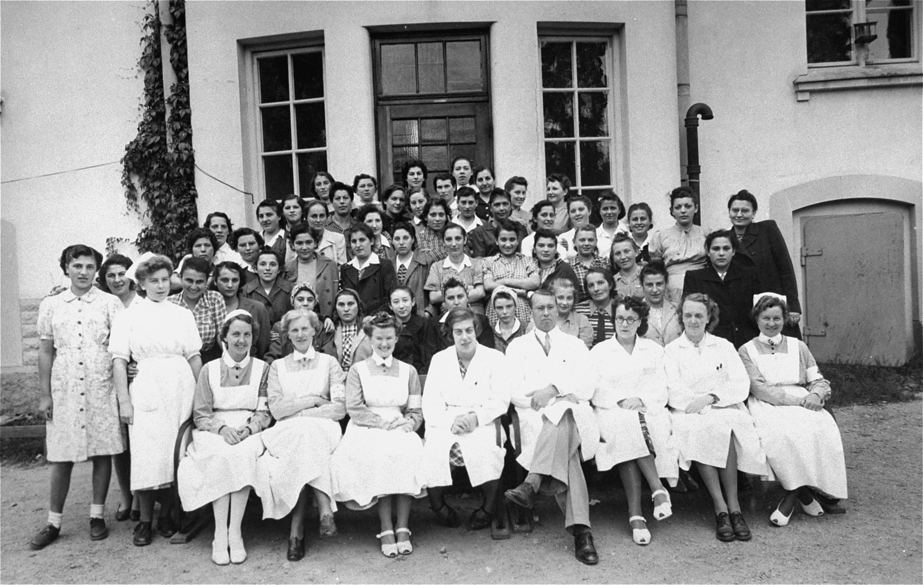 Group portrait of the staff and patients of a hospital and convalescent home for concentration camp survivors in Sweden.