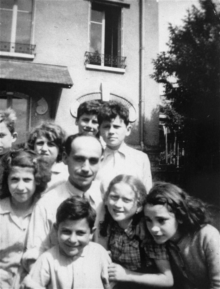 Group portrait of displaced children at an OSE (Oeuvre de Secours aux Enfants) children's home in Draveil, France.
