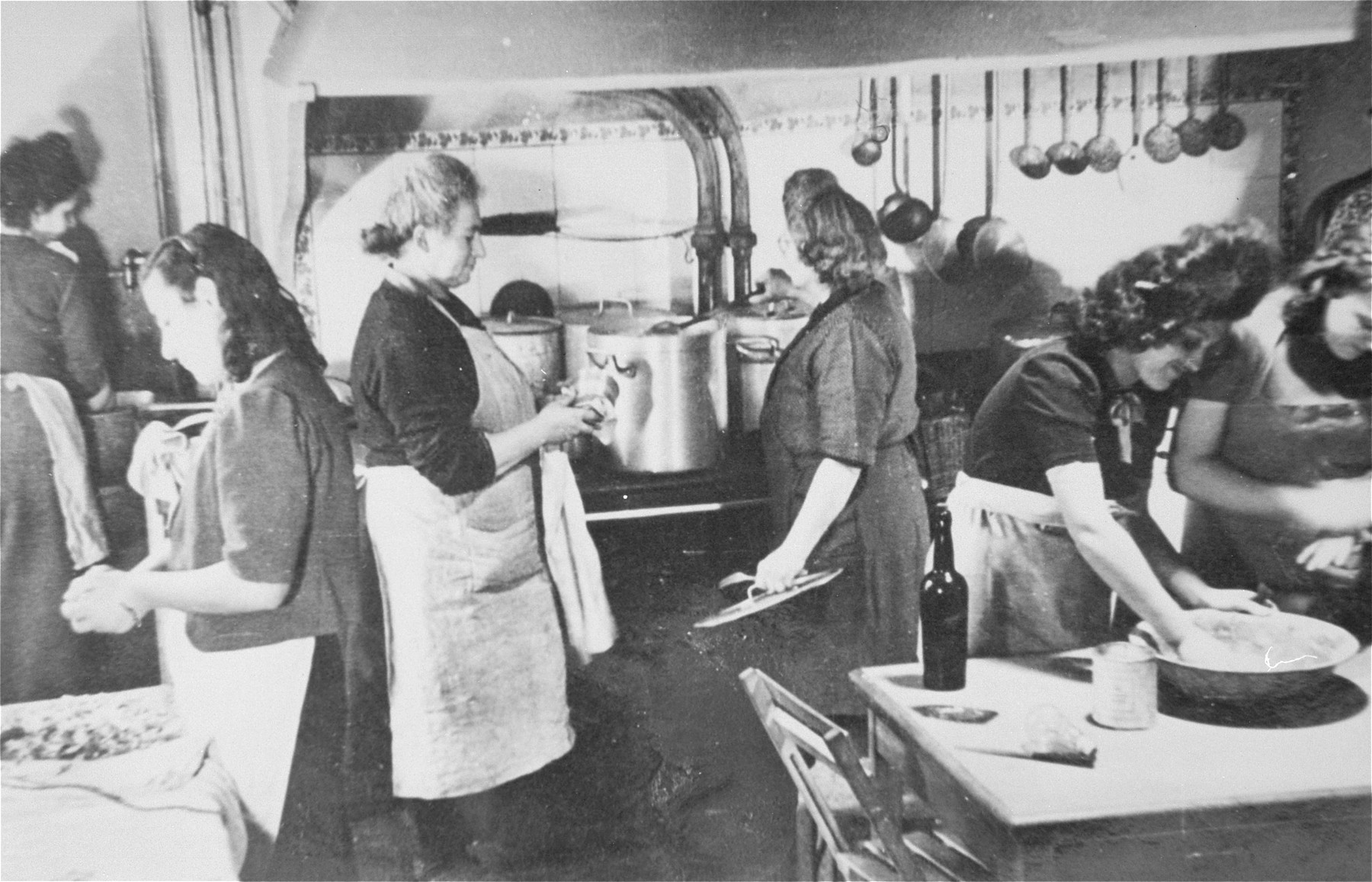 Women at work in the kitchen of the Le Tremplin children's home.