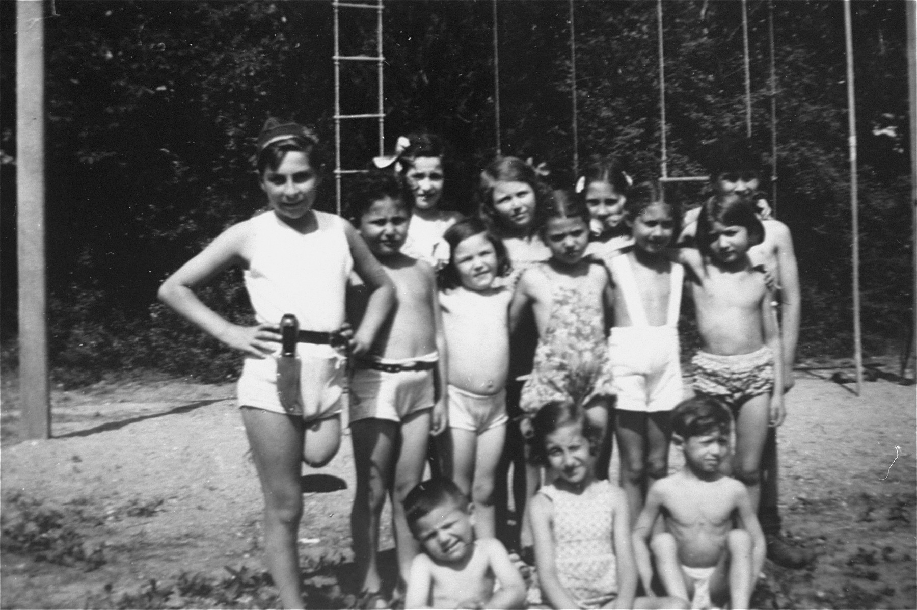 Group photograph taken at an orphanage for Jewish children in Verneuil.   Among these children is Evi Weisz.