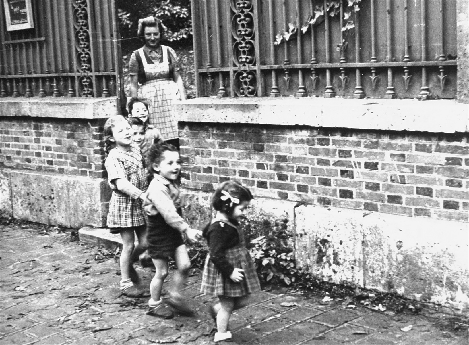 Children leaving the Le Petit Monde children's home to go on an outing.