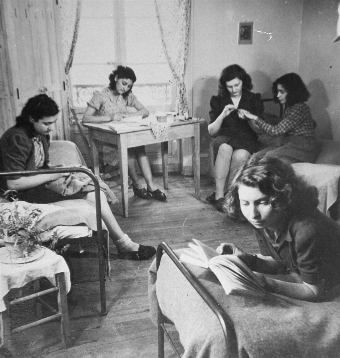 Young Jewish women living at the Le Tremplin children's home, relax in their room.