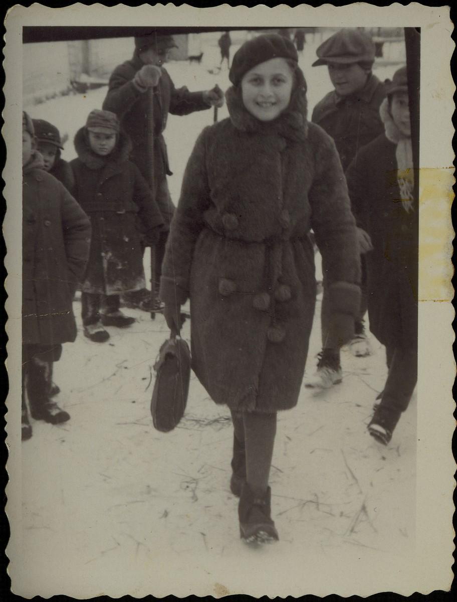 Hayya Shlanski walks through the market square on her way to Hebrew school.