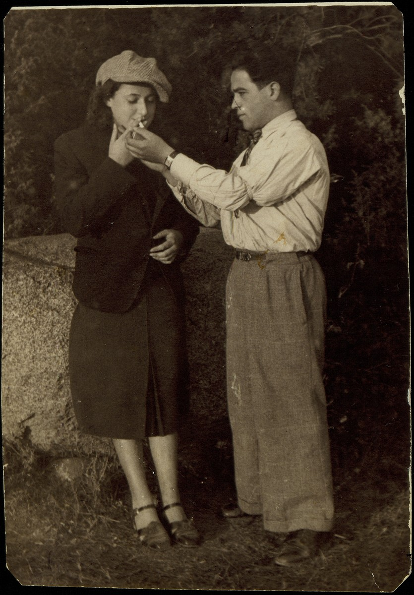Pessah Cofnas lights his wife's cigarette during an excursion to the Seklutski forest.