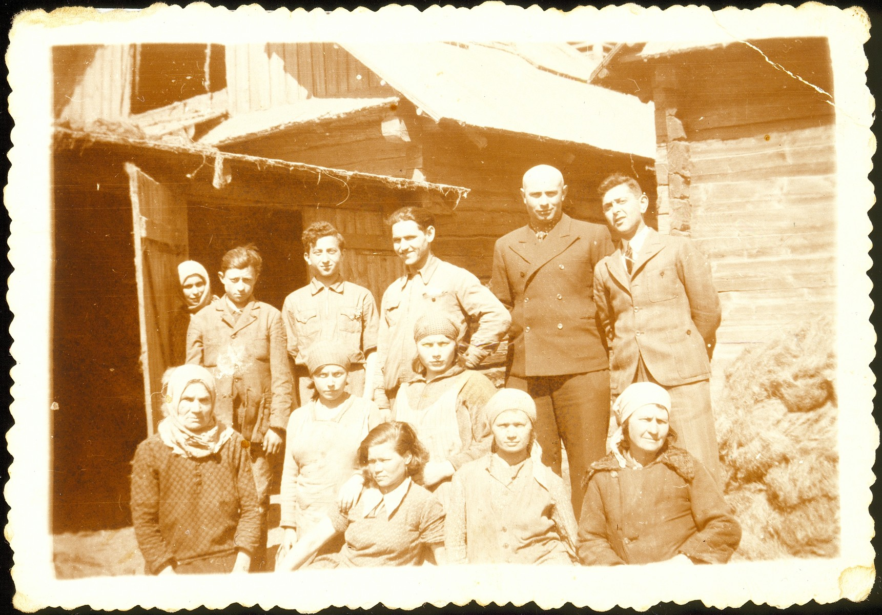 Workers at Mr. Derebiacki's linen factory.  Mr. Derebiacki is pictured second from the right.  Pesach Abrahamson is pictured third from the right.