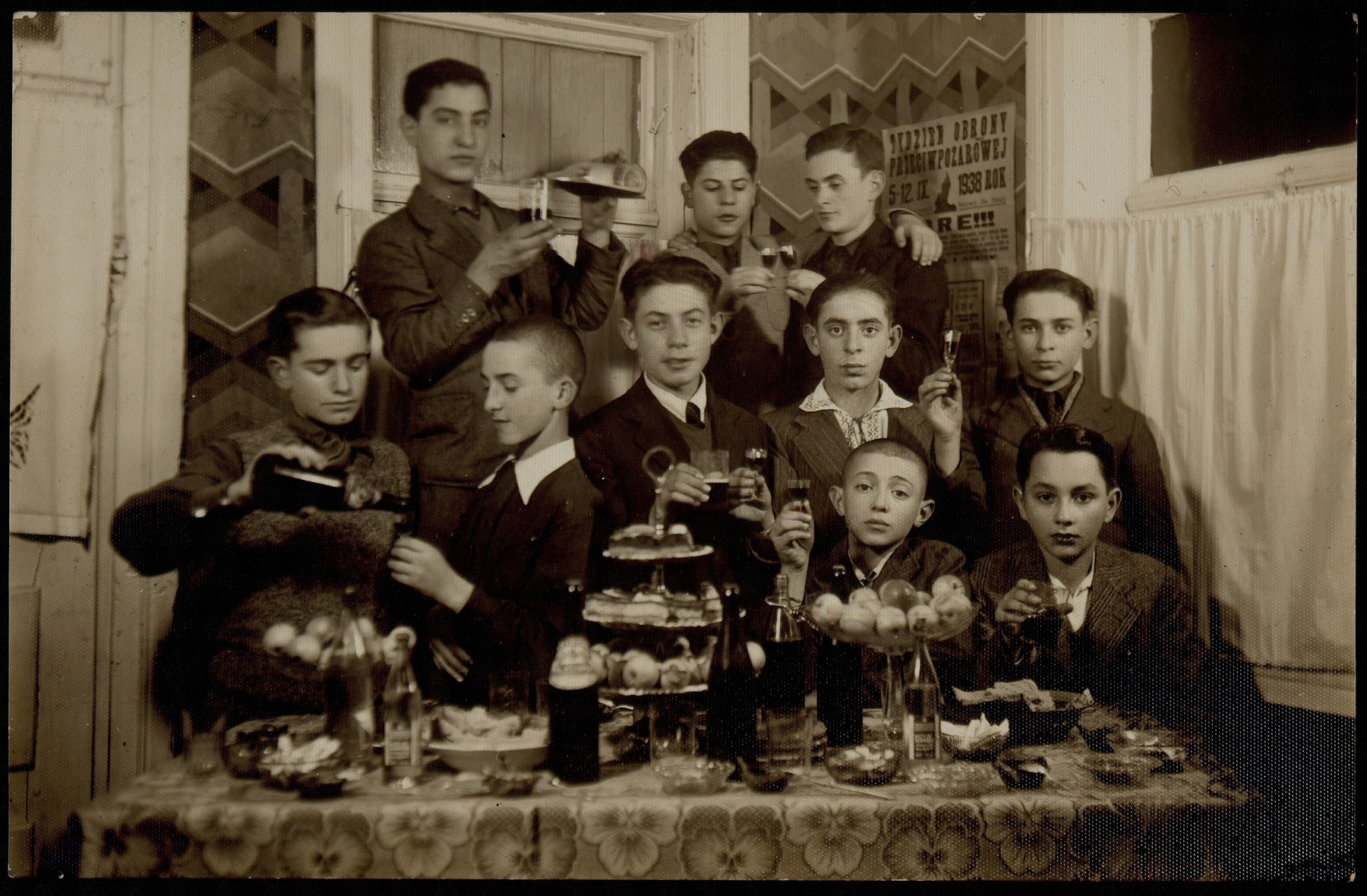 A farewell party for the Shlanski brothers in honor of their impending immigration to America.   Middle row (right to left): Benjamin Shlanski, Moshe Ginunski, Fischl Shlanski, unknown, Yehudah Gordon. Top row (left to right) Zalman Zubizki and Tuvia Blacher.  Names of other boys are unknown.