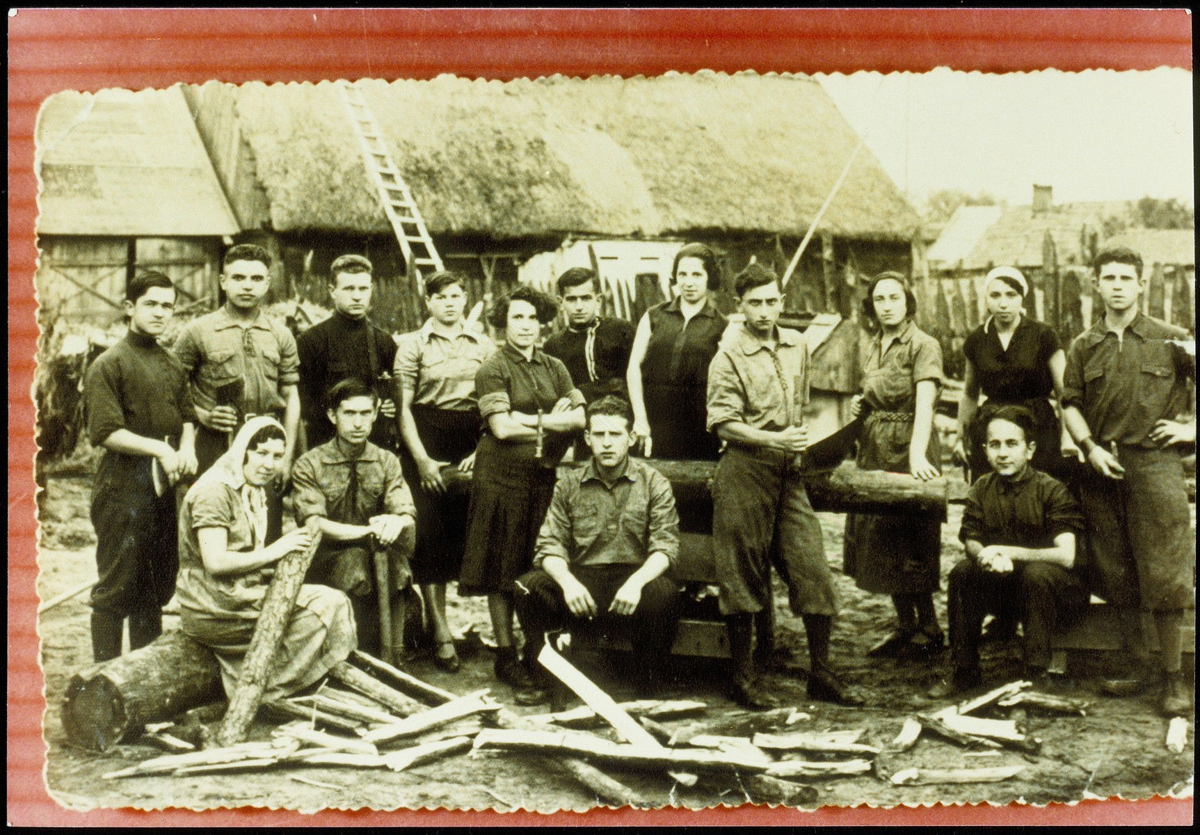 Members of a kibbutz hachshara in Wyszkowo gather in their lumberyard.  Zelig Ginsberg is pictured fourth from the right.  He survived the Holocaust in Siberia and then immigrated to Israel in 1948.