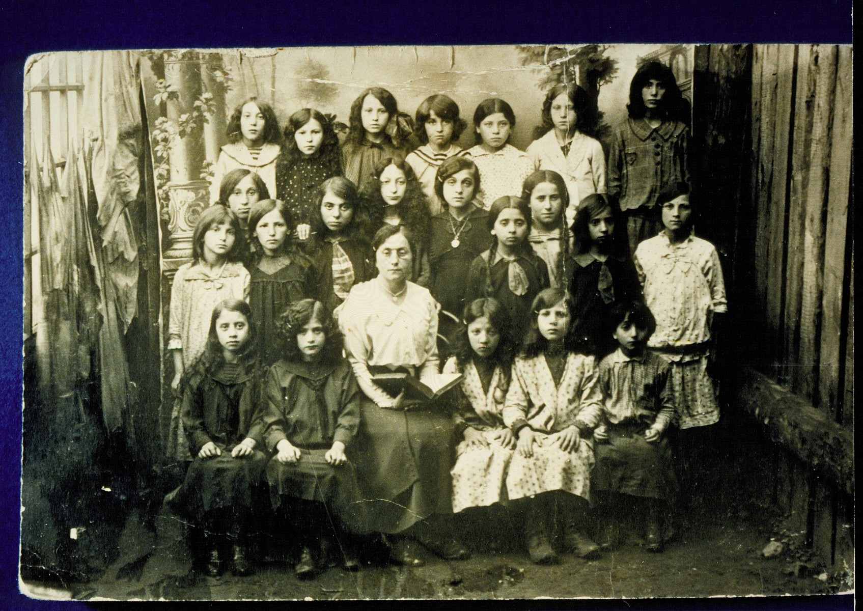 Students at the Yaffskaya Shkola, a school for girls founded circa 1911.   The school's official languages were Russian and German, with courses in Yiddish.  Sitting in the center is the founder, Mrs. Yaffe.  To her left is Zipporah Lubetski.    Zipporah and her sisters emigrated to Palestine and America, as did a few other girls in the photo.  The majority of the girls were murdered by the Germans during the September 1941 mass killing action in Eisiskes and other locations.