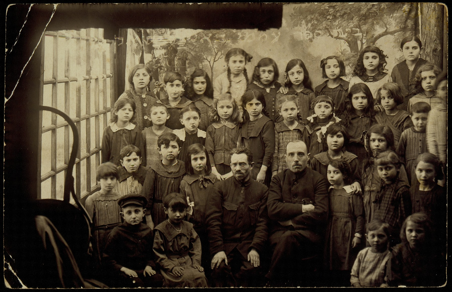 Young children and teachers pose for a studio school portrait.