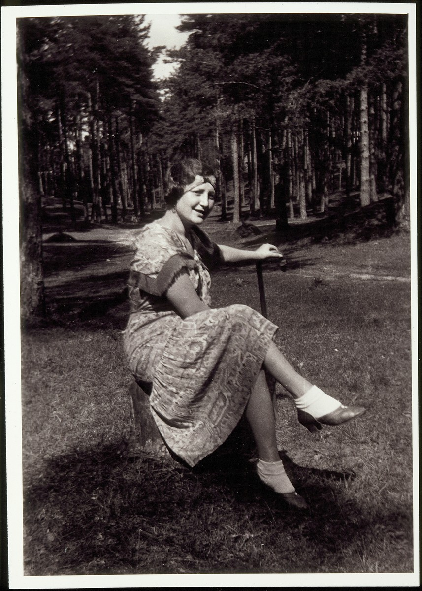 Margolia Saposnikow relaxes outdoors.   Margolia Saposnikow was a cousin of Rosalind Foster She was murdered during the Holocaust.
