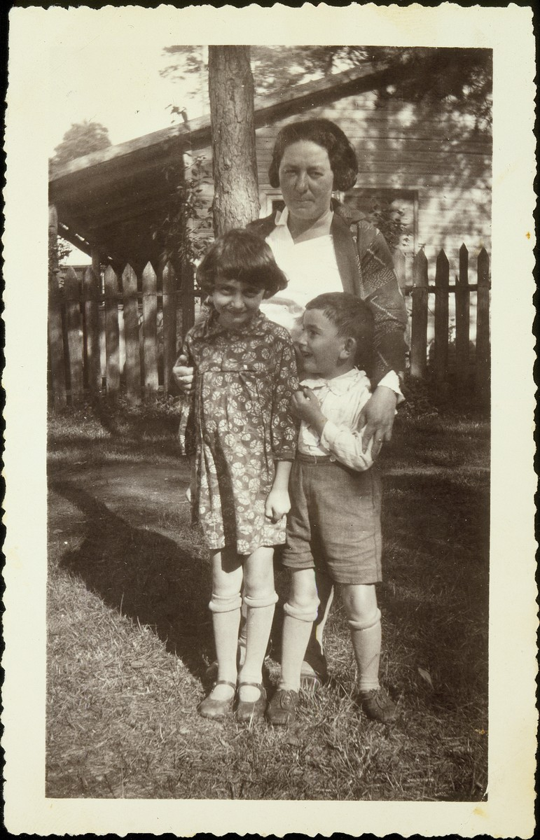 Mrs. Zyskind, a relative of the Virshubski family poses with her children, in Pospieszka.   Mrs. Zyskind and her family were murdered during the Holocaust.