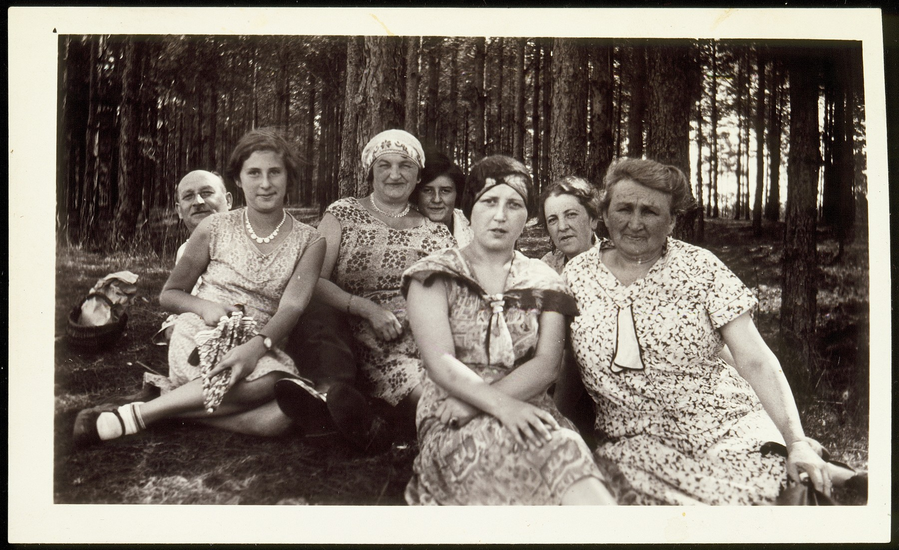 Family portrait taken in a wooded area not far from Vilna.  Front row, from right to left; Annie Virshubski Foster, Margolia Saposnikow, Sonia Virshubski Saposnikow and Nachama Saposnikow. Sitting in the back from right to left, Mrs Levenson, Golda (last name unknown) and Hillel Saposnikow.