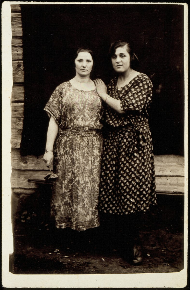 Zipporah Lubetski Tokatli (right) poses with a relative in front of her parent's home prior to her immigration to Palestine.