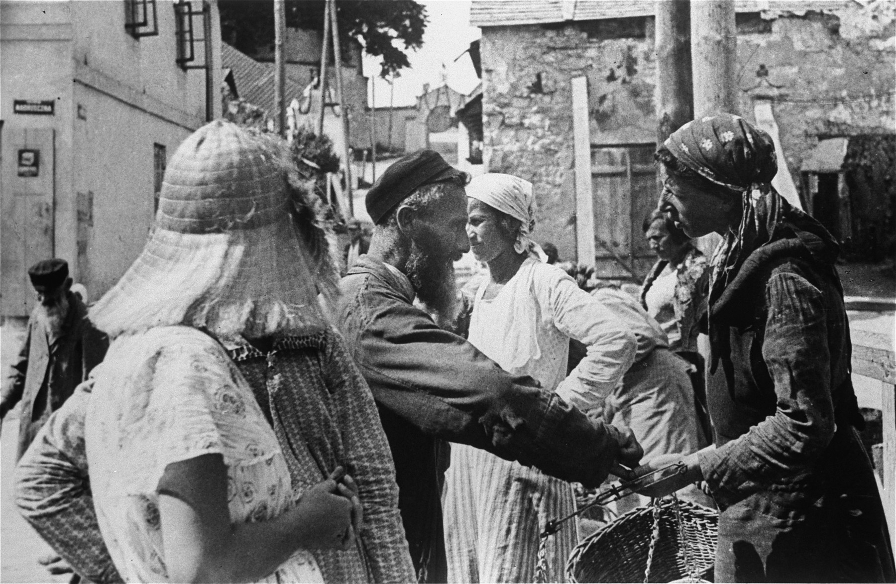 Close-up of Jews buying and selling in an open air market in Kazimierz Dolny