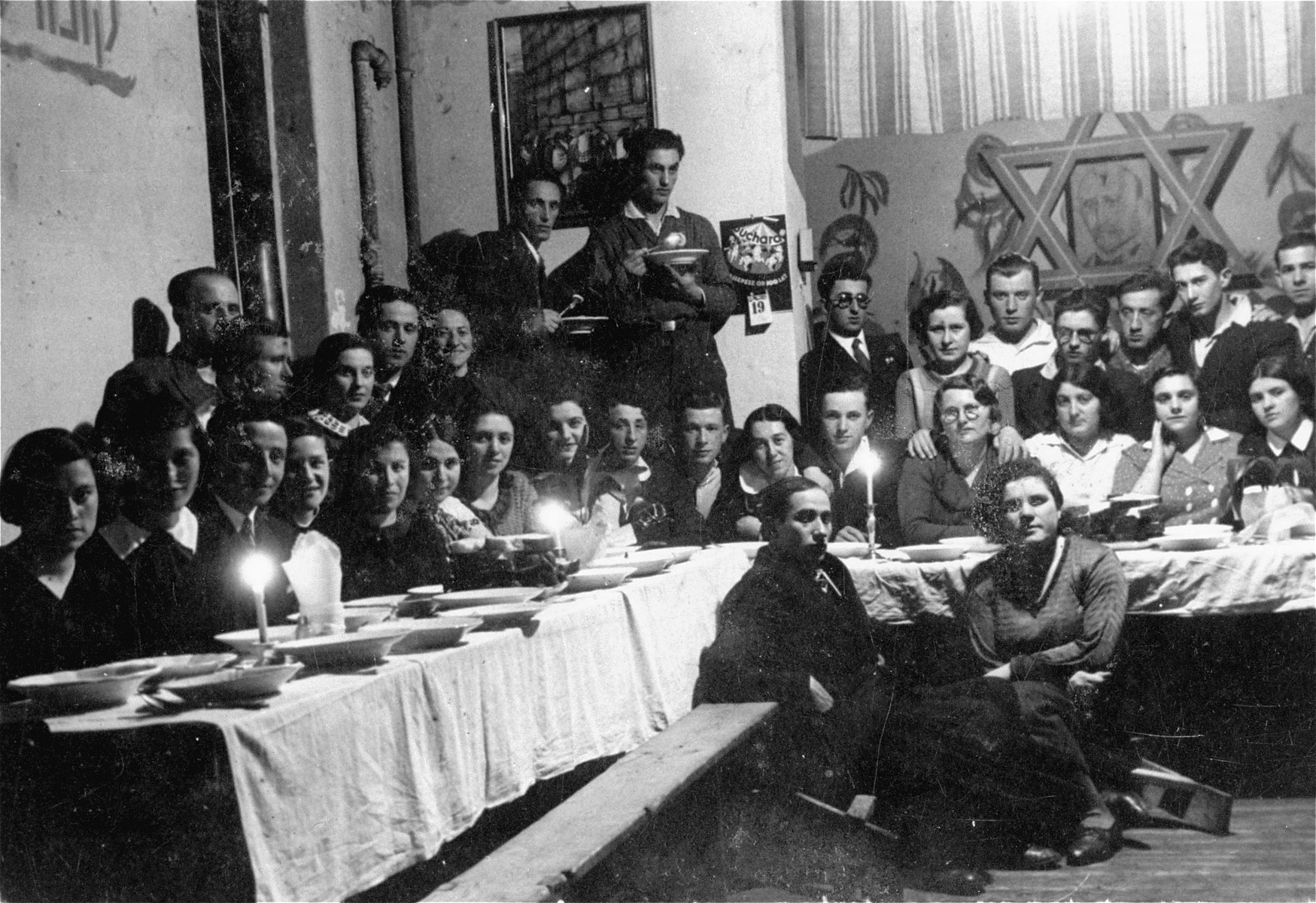 Group portrait of members of a hachshara, a Zionist youth collective, at a banquet in Katowice.