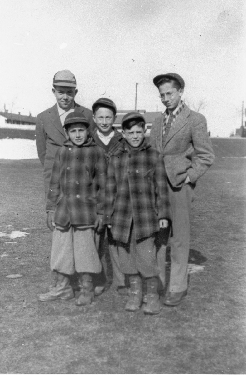 Group portrait of five boys living at the Fort Ontario emergency refugee shelter in Oswego, New York.   Among those pictured are Leon Minz (first from the right) and Zigmund Krauthamer (standing in front of Minz).