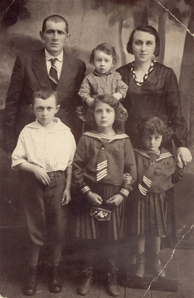 Portrait of the Raboy family in Berezno, USSR.    Pictured are Abraham and Feiga Raboy and their four children: Buncia, Shaindel, Beila, and Aron.  Only Aron survived the war.