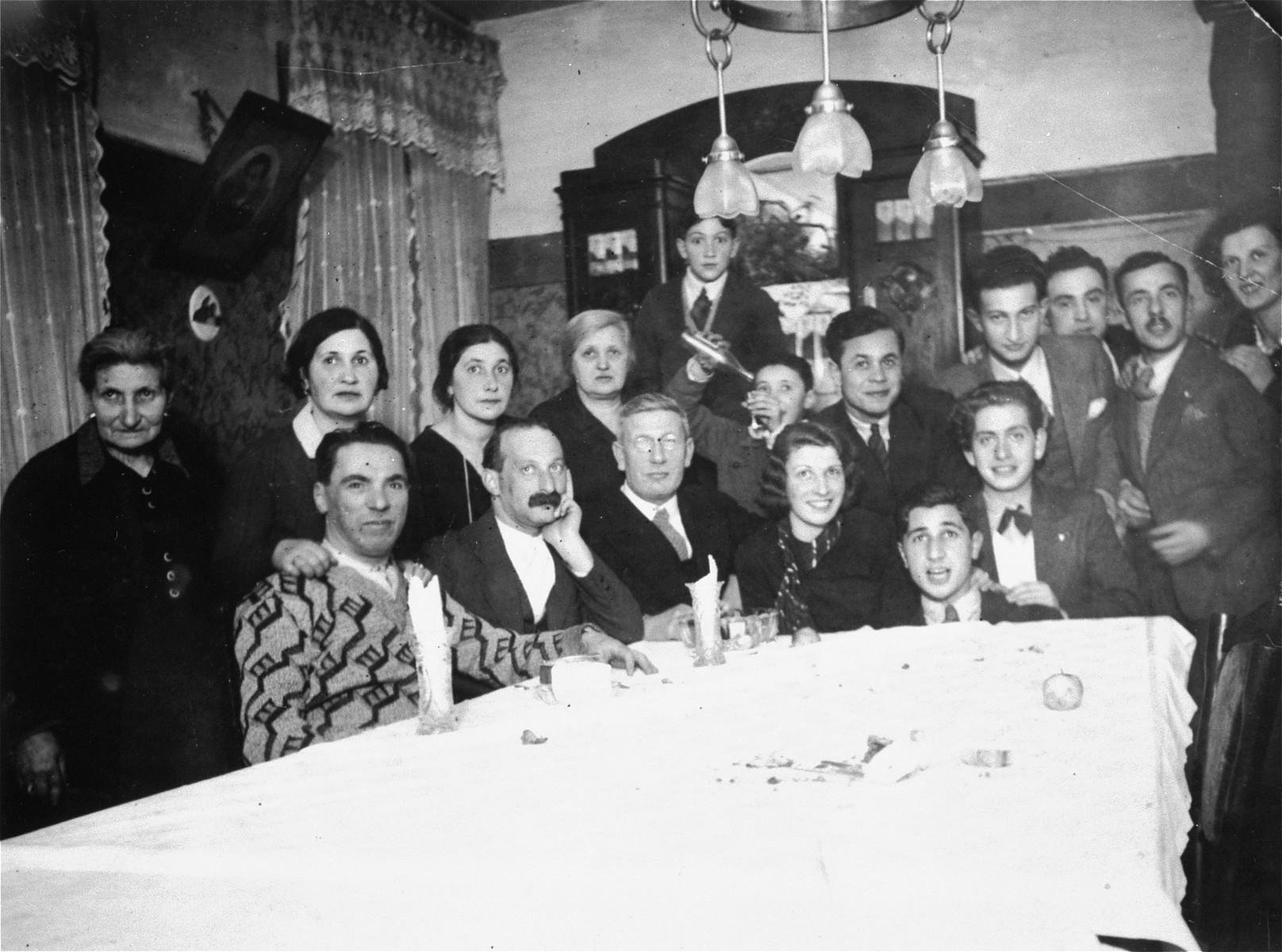 The Magid family at a house party in Vilna.    Among those pictured are Raya, Boris and Genya Magid.  The donor, Genya Markon, is the granddaughter of Abram and Genya (Settel) Magid of Vilna.  The Magids had two daughters, Raya and Katia.  Raya Magid met Alexander Markon, a Jewish émigré living in France, while he was visiting his family in Vilna.  When Alexander returned to France, he and Raya carried on a courtship by mail, and the two were married in Paris on February 11, 1937.  In 1939, Alexander, who had served in the French army in 1927-1928, was recalled to the military.  Following his demobilization in the summer of 1940, he joined Raya, who had moved to Toulouse.  While waiting for permission to immigrate to the United States, she gave birth to their first child, Alain, on June 13, 1941.  In 1942 their visas arrived and they booked passage to the U.S. aboard the Portuguese liner Carvalho Araujo.  The ship left Lisbon in late October, arriving in Baltimore on November 2, 1942. Genya Magid died a natural death in Vilna in 1939.  With the German invasion of 1941 Abram and Katia were forced into the Vilna ghetto.  Abram was killed that same year during an action in Ponary.  Katia survived the concentration camps of Kaiserwald and Stutthof.