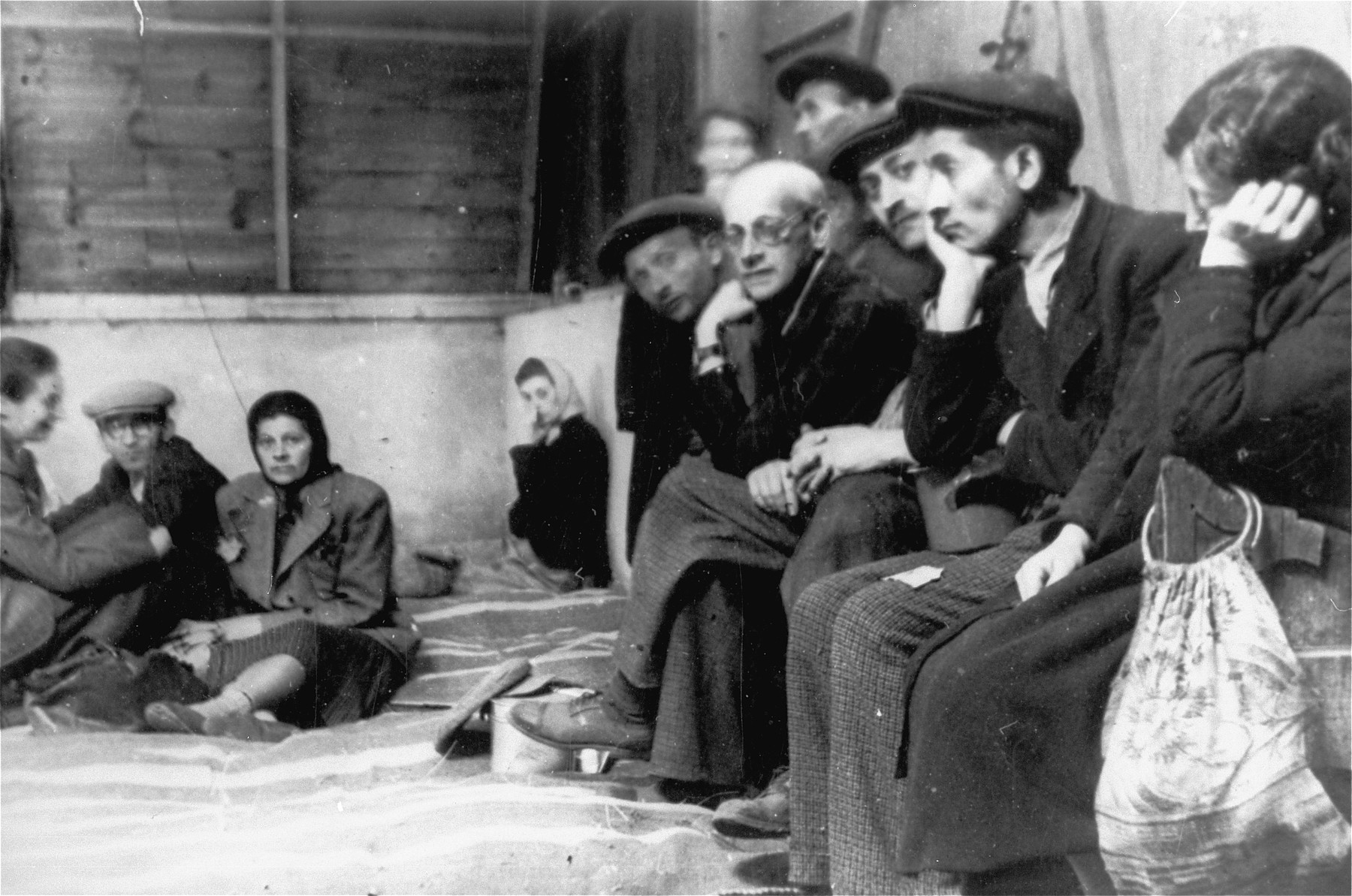 Jews who have been rounded-up for deportation in the Lodz ghetto are held at an assembly point on Krawiecka Street until trains are available to transport them out of the ghetto.