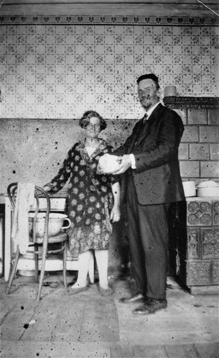 A Jewish couple poses in the kitchen of their home in Jaroslaw, Poland.  Pictured are Jacob and Miriam (Reich) Ringelheim, the donor's grandparents.