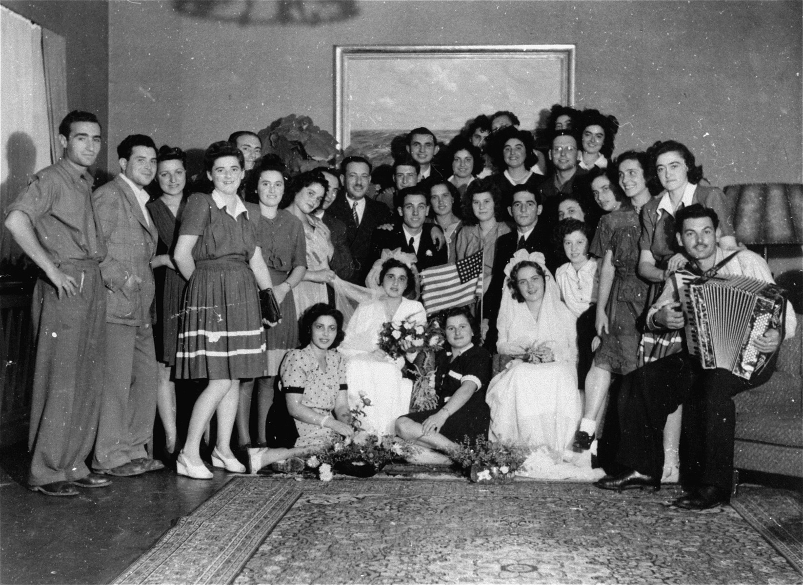 Group portrait of the wedding parties at a double ceremony in the Feldafing displaced persons camp.