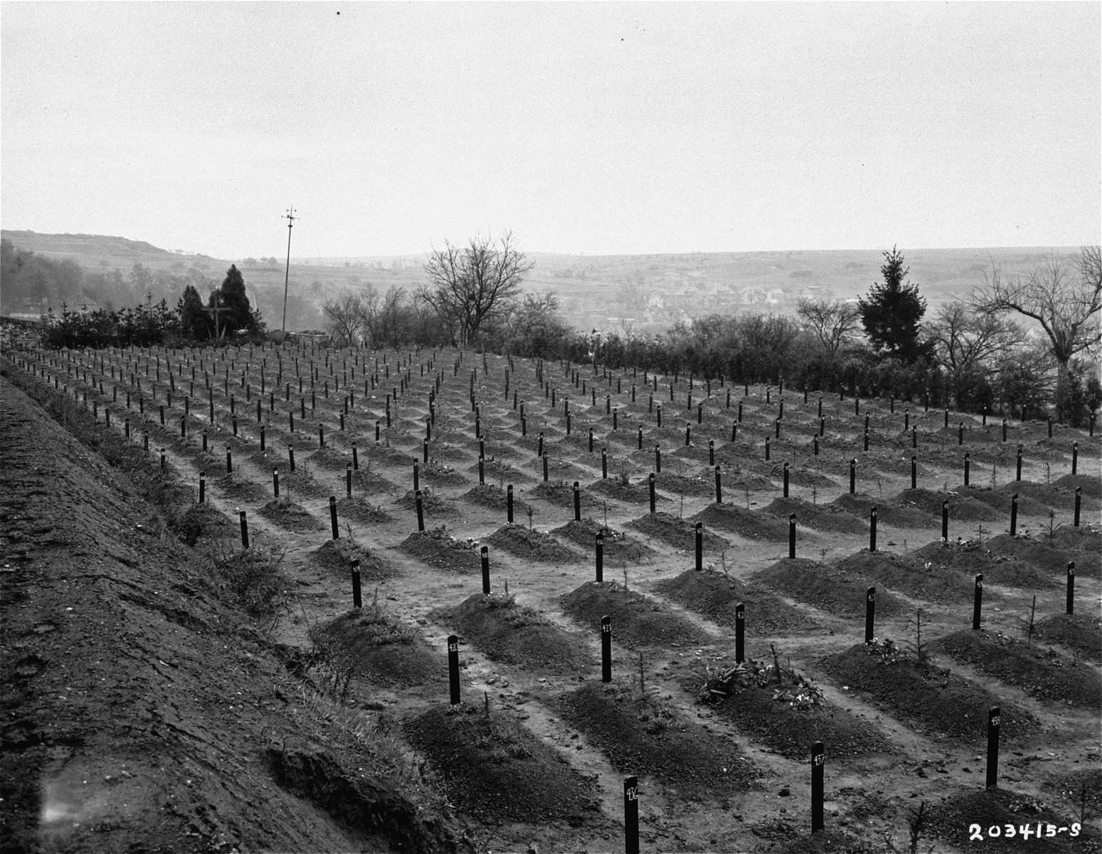 View of the cemetery at the Hadamar Institute, where victims of the Nazi euthanasia program were buried in mass graves.  The photograph was taken by an American military photographer soon after the liberation.