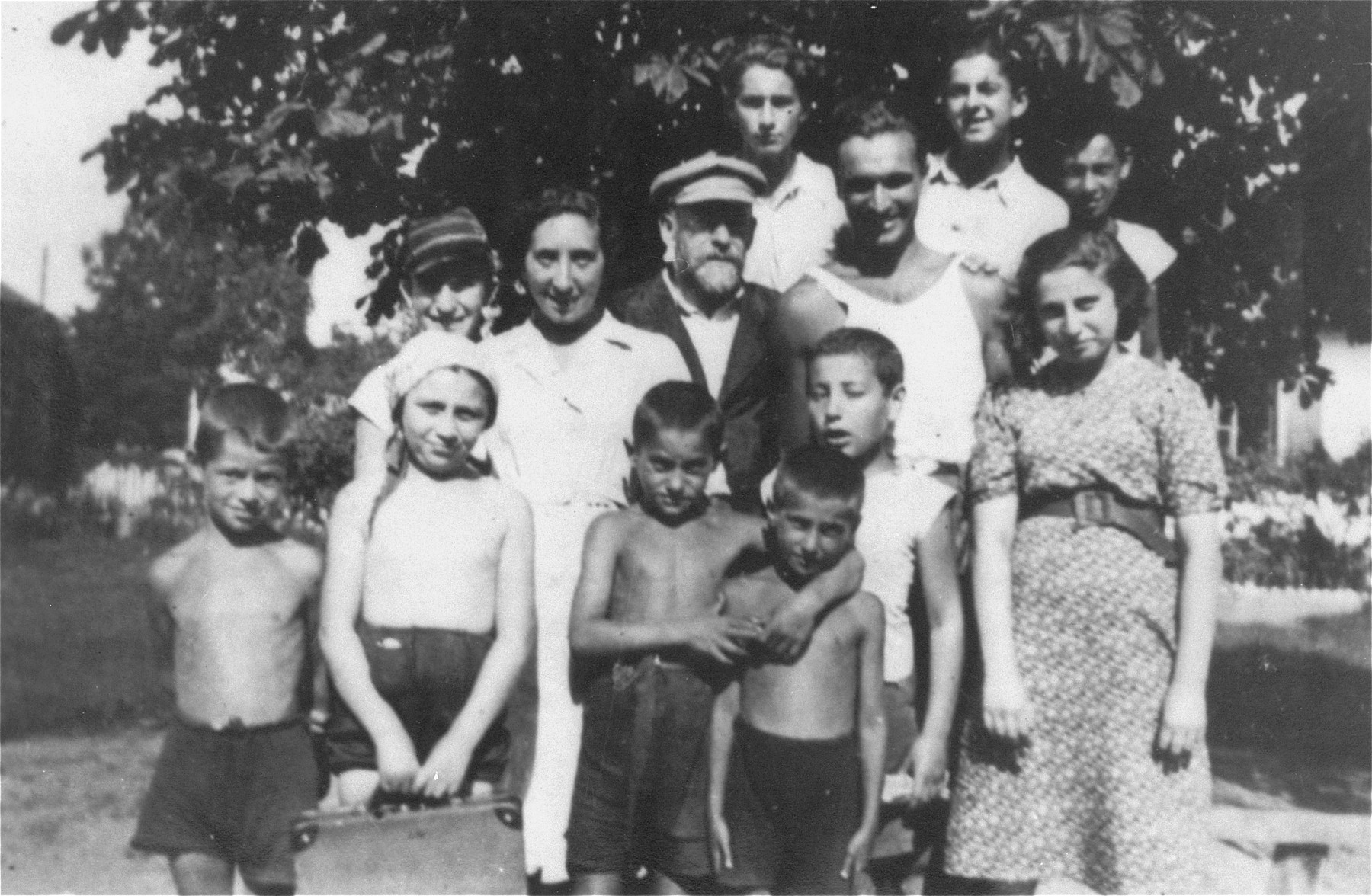 Janusz Korczak and Sabina Lejzerowicz pose with children and staff members at the Rozyczka farm, a summer retreat for the children who reside at the Krochmalna Street orphanage in Warsaw.