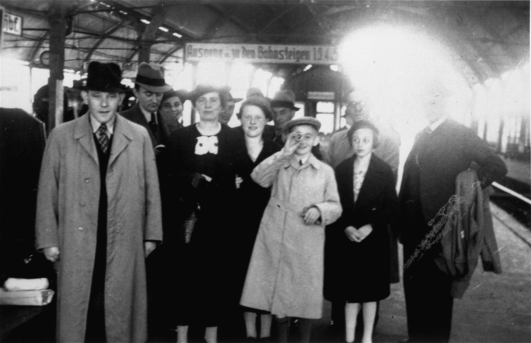A Jewish family poses at the train station before leaving Germany for the United States.  Among those pictured are Sol and Henrietta Meyer with their son Harvey.  The Meyers are the aunt and uncle of the donor, Jill Berg Pauly,